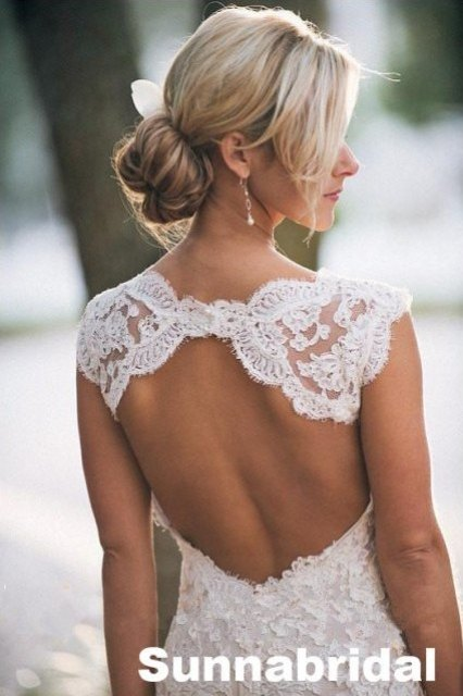 Ivory open back A-line lace chapel train wedding dress