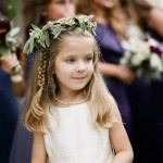 side-braid-flower-girl-hairstyle-with-flower-hoops